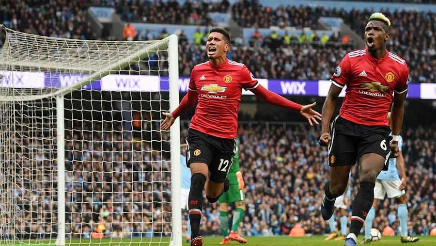 Utd fight back to delay City title celebrations