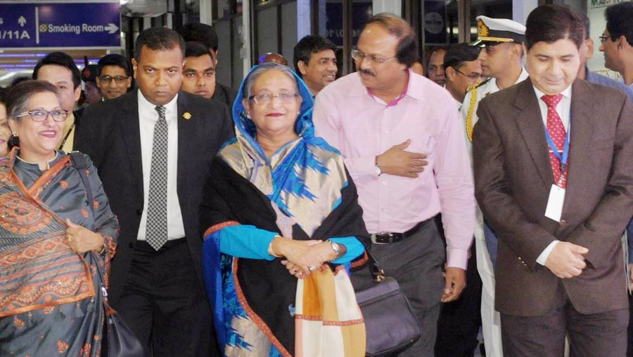 PM returns home from Australia