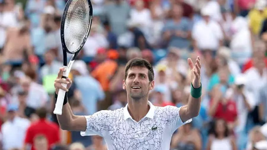 Djokovic makes history with win over Federer