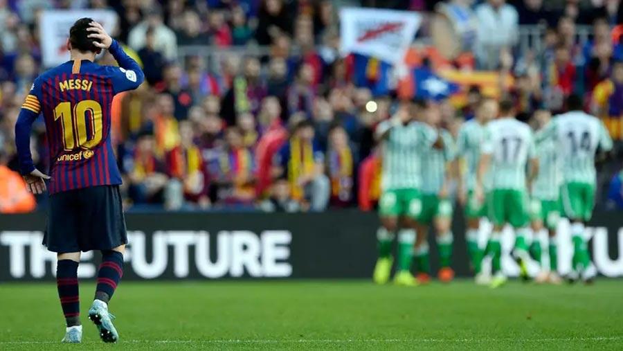 Barca stunned by Betis despite Messi return