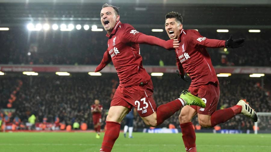 Liverpool beat Man Utd to go top