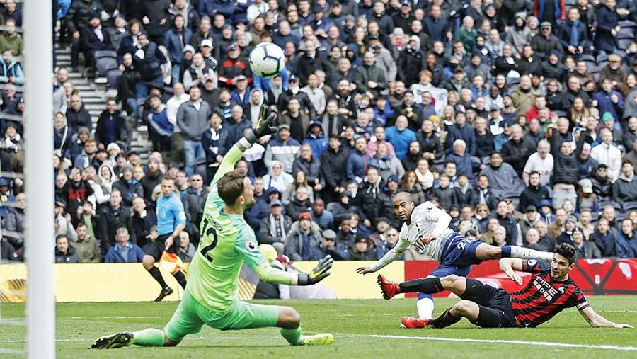 Lucas treble fires Tottenham into third