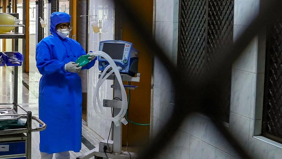Virus cases in China fall again as deaths top 2,000