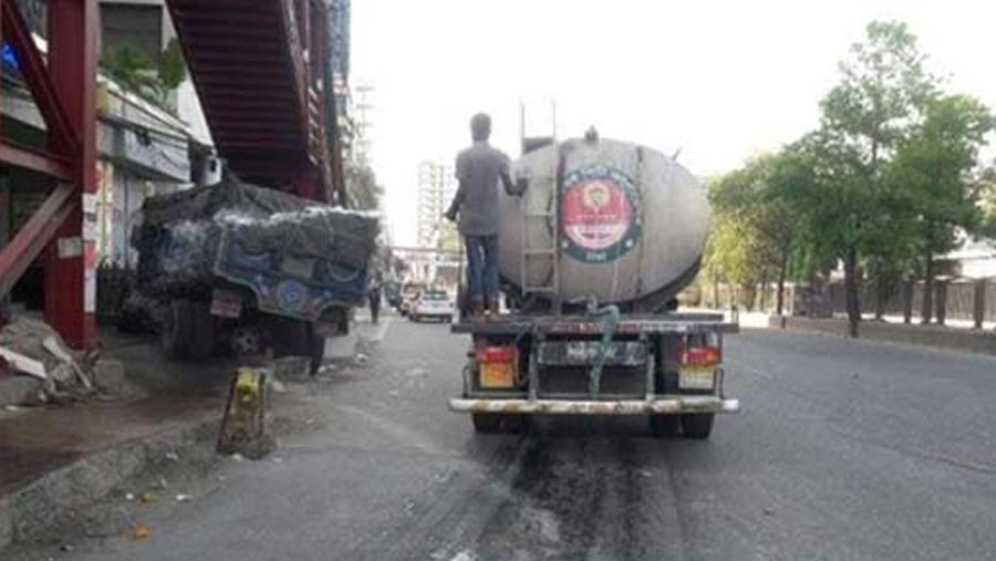 Antiseptic liquid being sprayed in Dhaka