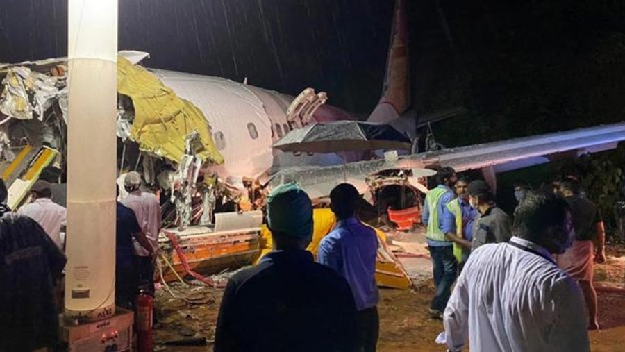Air India jet breaks in two in Kerala killing 18