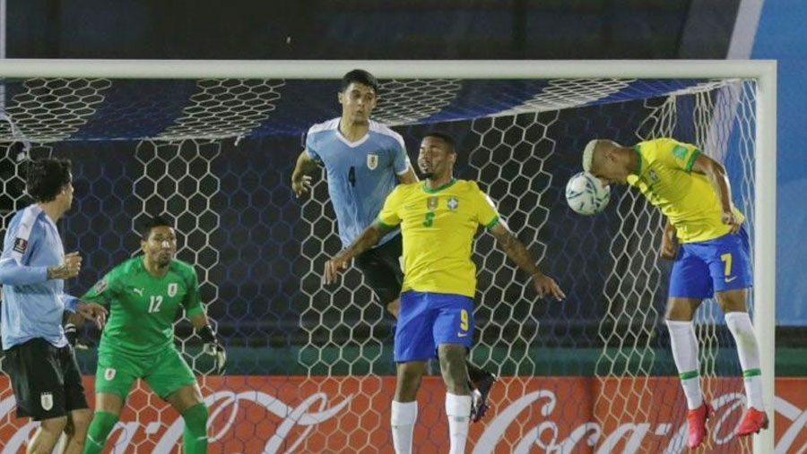 Brazil beat Uruguay 2-0 to stay top