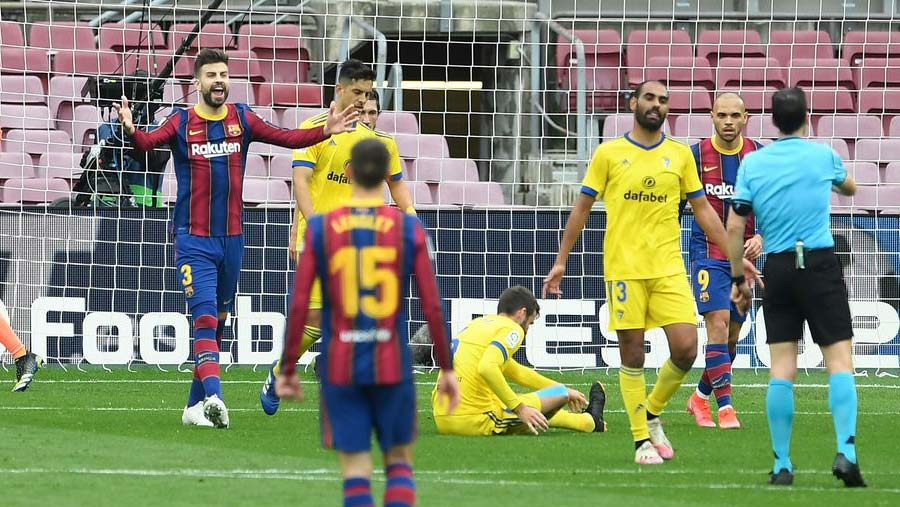 Cadiz ends Barca's winning run